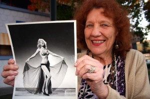 Sacramento resident Patty Russell shows off a photograph of herself taken during her heyday as a burlesque dancer.