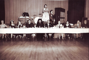 Penny Kastanis sings during an event honoring a bishop's visit in about 1954. The event was held at the Hellenic Center, which is located just east of the church. (Photo courtesy of the Greek Orthodox Church of the Annunciation)
