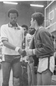 Jesuit High's Chris Lorenc shakes hands with Sacramento High's Chris McMurray at the 1969 basketball Tournament of Champions, which was won by Jesuit High. (Photo courtesy of Jesuit High School)