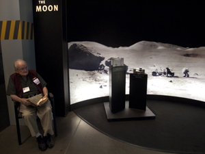 Docent and moon rock at the Aerospace Museum of California, 3200 Freedom Park Dr. (Photo courtesy Robert Couse-Baker)