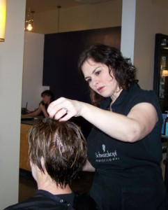 Jennifer Benton, owner Artisan Salon, at work at her new shop after moving her salon location across Riverside Boulevard. (Photo by Linda Pohl)