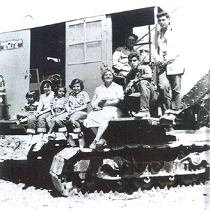 Shown left to right, Linda Azevedo, Carolyn Azevedo Peters, Patsy Azevedo, Rosie Azevedo de Oliveira, Carrie Azevedo, John Azevedo, Jr. and Richard Azevedo gather together with dragline operator John Azevedo (seated in background). John Azevedo dug 75 percent of the present-day Lake Greenhaven, which was once the brick company's clay pit. (Photo courtesy of PHCS)