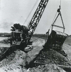 John Azevedo, seated to the left, used this dragline to gather clay and load it into locomotive cars, shown to the right of this photograph. (Photo courtesy of PHCS)