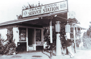 Louie Enos stands next to a gasoline pump during the late 1920s at the Frank Enos Service Station, which was the only service station in the area south of Y Street (today's Broadway). (Photo courtesy of PHCS)