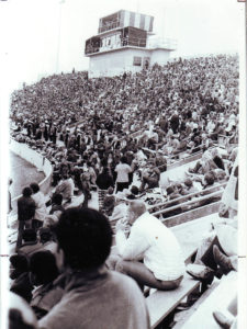 A large crowd observes an event at Hughes Stadium. (Photo courtesy of SCC Special Collections)