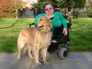 Canine and human companions, Beth Graham and her Canine Assistant, Sajak, are a team. Sajak helps Beth maintain an independent life both at home and in the workplace. (Photo by Susan Laird)