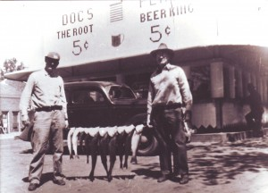 Standing in front of Doc's Place in the early 1930s, Doc Campbell (left) and his friend, Neil Bronsima, show off the results of their fishing trip. / Photo courtesy of Jim Campbell