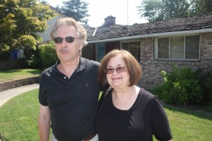 Don Silveira and Diane (Silveira) Cortopassi stand in front of the former Land Park residence of their parents, Gabe and Gloria Silveira. / Valley Community Newspapers photo, Lance Armstrong