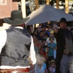 "In a reenactment, ""Cole Younger,"" played by Bobby Hubbell, fires a pistol while his partner, ""Wild Bill Hickock,"" played by Eric Leimtz, aims."