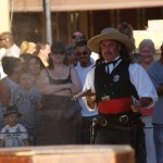 """Wild Bill Hickock,"" played by Eric Leimtz, fires rifle and pistol in a reenactment."