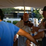 Violinist Bill Alexander, of the Sacramento Ballroom Society, plays as participants dance the Virginia Reel.