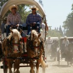 Wagons and dust fill the streets of Old Sacramento just as if it was the 1850s.