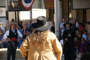 """Wild Bill Hickock,"" played by Eric Leimtz, and ""Wyatt Earp,"" played by Fred Pedersen, face their enemy in a reenactment."
