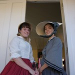 Monica Lenk and Kathy Lowy stroll Old Sacramento in 1850s costumes.