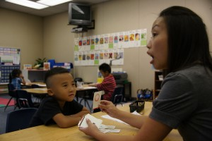 Kindergartener William Vang pays close attention to his teacher, Chue Lo, at the Yav Pem Suab Academy. Students at the charter school will study the Hmong language, in addition to their studies in English, math, science and social studies. / Valley Community Newspapers photo, Danny Kam