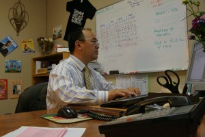 Dream. Believe. Inspire. Achieve. Principal Vince Xiong hard at work in the office that was only a dream not too long ago. Xiong and leaders of the Hmong community worked for five years to establish the Yav Pem Suab Academy. / Valley Community Newspapers photo, Danny Kam