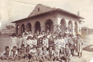Schoolchildren gather in front of Sutter School in this c. 1925 photograph. / Photo courtesy of PHCS