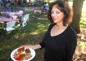Anne DeFazio shows off a plate of Italian foods made by attendees of the picnic. / Valley Community Newspapers photo, Lance Armstrong
