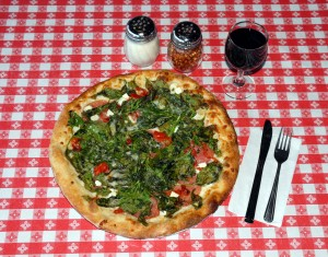 The Pizza Rustica is prepared without sauce. It features Giovanni's hand-stretched dough, topped with Italian salami, fire roasted red peppers, spinach, ricotta salata, Romano cheese and mozzarella and extra virgin olive oil. / Valley Community Newspapers photo, Tom Paniagua
