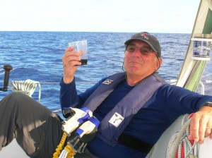 "Caplan says that sailing long distances across the Pacific Ocean involves ""hours of boredom punctuated by moments of sheer terror."" Here, he relaxes during one of the quieter moments on board. / Photo courtesy"