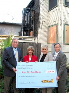 Golden 1 senior vice presidents Scott Ingram, Tammy Davis and Bill Thorla present River City Food Bank Executive Director Eileen Thomas with a $5,000 check to help with the fire restoration project.