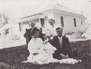 Genevieve Moore – now Genevieve Cobb – is shown in the arms of her mother in this 1908 photograph. Also shown in the photograph are Genevieve's father (seated next to her mother) and her grandparents. / Photo courtesy, Genevieve Cobb
