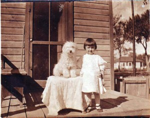 Genevieve Moore – now Genieve Cobb – is shown with her dog in this photograph, which was taken in about 1910 in Greeley, Colo. / Photo courtesy, Genevieve Cobb