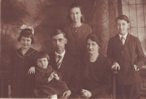 The Moore family is shown in this c. 1921 photograph. They are (left to right): Meredith, Juanita, Delbert, Genevieve, Effie and Randall. The fifth child of the family, Darrell, was not yet born at the time when this photograph was taken. / Photo courtesy, Genevieve Cobb
