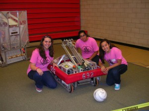 "Members of the St. Francis Robotics team (the ""Fembots"") with their newest creati"