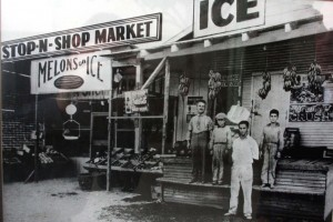 A.G. Kassis and three of his five sons (left to right), Walter, Frank and John, stand in front of the first Stop-N-Shop grocery store at 2800 Y St. (present day Broadway) in about 1928. / Photo courtesy of the Kassis family