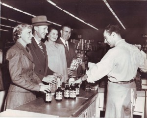 Bill Kassis (far right) serves customers (left to right) Malcom F. Gee, Janice Gee, Chet Coppin and Lana Coppin at the Riverside Boulevard Stop-N-Shop store in about 1950. / Photo courtesy of the Kassis family