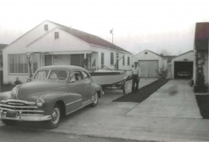 Bernie Hart stands behind his boat and car in the driveway of his Janey Way home in about 1951. / Photo courtesy, Tom Hart