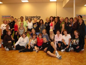"Dedicated to healthy habits and a healthy community, these Jazzercisers gathered for a ""Huff Before You Stuff"" class at Land Park/Greenhaven Jazzercise on Nov. 25. Each person brought items to donate to the Sacramento SPCA in memory of Olive, a Pocket resident dachshund who passed away last fall. / Photo courtesy"