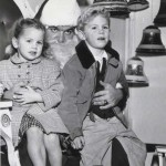 Missy Jones – now Missy Stonehouse – spends a moment with Santa Claus and her brother, Jeff Jones, in this 1952 photograph. / Photo courtesy, Missy Stonehouse