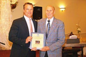 Chris Meyer presented Major A. Nilson, DVM, with a plaque honoring the World War II veteran and humanitarian as the Carmichael Chamber's 2011 Business Person of the Year. Nilson has been with the chamber for over 56 years. / Valley Community Newspapers photo, Bill Condray