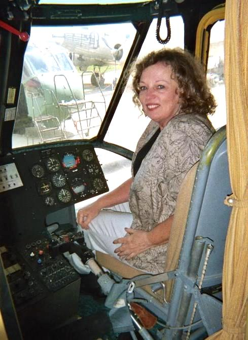 "Co-author Jackie Boor seated in the cockpit of Nixon's ""Last Flight"" helicopter during its restoration at March Air Reserve Base in 2006. / Photo courtesy"