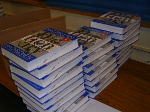 Brand-new dictionaries were neatly stacked before the presentation to the third graders. / Valley Community Newspapers photo, Susan Laird