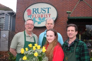 Back row, left to right, Greg, Dennis and Marty Rust and Julia Hamshar (holding yellow roses) of Rust Florist stand in front of this East Sacramento business, which is celebrating its 40th anniversary. / Valley Community Newspapers photo, Lance Armstrong