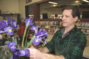Marty Rust prepares a blue iris arrangement at Rust Florist in East Sacramento. / Valley Community Newspapers photo, Lance Armstrong