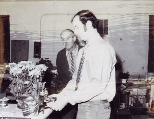 George Rust and his father Joe Rust (background) work at Rust Florist in this 1970 photograph. / Photo courtesy, Rust Florist