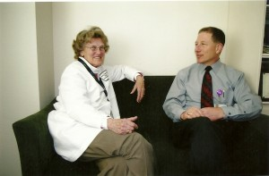 Sister Catherine Connell, SSS and Dr. Robert Kuxin, head psychiatrist at South Sacramento Kaiser's Department of Psychiatry, collaborate on a patient's history.