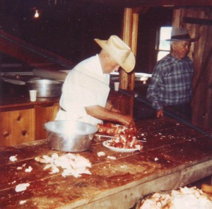 "Faustino Silva wears an off-white Stetson hat while preparing beef for the Riverside Holy Ghost Festa dinner during the 1940s. Standing to the right of Silva is Antone Perry ""Peru"" Dutra, another well-known resident of the area during this time. / Photo courtesy, PHCS"