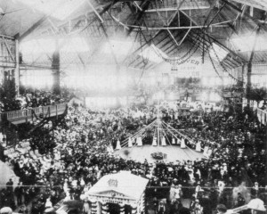 "This May 6, 1885 photograph shows a western view of the interior of the Pavilion at 15th and N streets during the floral festival honoring Margaret Crocker. Near the center of the photograph are young girls dancing around a maypole, while a banner reading, ""Lover of Our Homes,"" hangs in the background. / Photo courtesy, Crocker Art Museum"