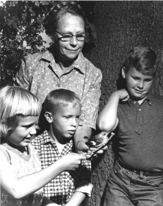 Effie Yeaw gives local schoolchildren an up-close view of a bird at Deterding Woods in this 1960s photograph. / Photo courtesy, Effie Yeaw Nature Center