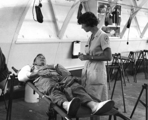 An American Red Cross worker speaks to an injured soldier in a field hospital in Vietnam. / Photo courtesy of the American Red Cross