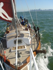 Jack G. Payne sails on the San Francisco Bay, north of the Bay Bridge. / Photo courtesy of Jack G. and Brenda Payne