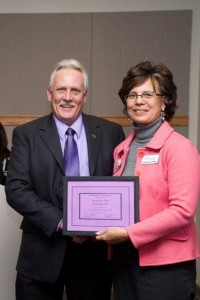 Virginia Stone receives an award on behalf of Carmichael Oaks from Dale Masters, chairman of the Alzheimer's Memory Walk committee. / Photo courtesy Carmichael Oaks Senior Living
