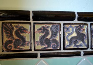 Julia Morgan custom designed tiles for the residence. Tiles and exterior frieze work depict the figures of griffins and dragons. / Valley Community Newspapers photo, Tom Paniagua