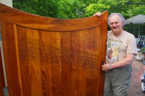 Michael Neumann shows off his Beethoven Symphony No. 9-themed gate, which leads to his home studio. / Valley Community Newspapers photo, Lance Armstrong