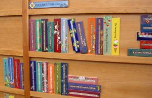 """The Friends of the Robbie Waters Pocket-Greenhaven Library are raising funds for the library by selling beautiful wood """"book spines"""" that will be installed into a """"bookcase"""" on permanent display in the library. This already installed """"bookcase"""" at the Folsom Public Library in the children's section is shown for illustrative purposes. The RWPG Library display will have its own character, one that will be as unique and creative as its patrons and community groups. / Valley Community Newspapers photo, Susan Laird"""